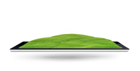 Green field on tablet computer Stock Photo