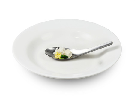 modicum food on spoon, Concept of food shortage, poor Stock Photo
