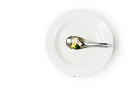 austere: modicum food on spoon, Concept of food shortage, poor Stock Photo
