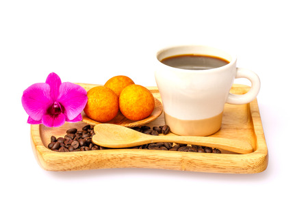 Coffee  in the white cup and golden ball fried pastry   for breakfast, isolated on white background.