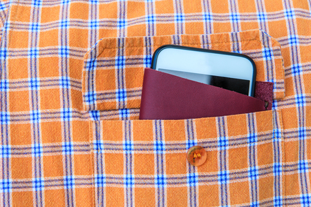 Cellphon and beautiful leather case in the orange shirt pocket.