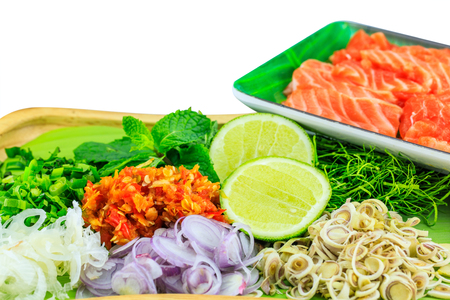 Ingredients for spicy salad salmon isolated on white background .