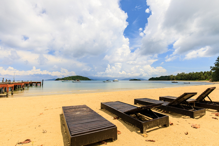 wooden chair on the tropical beach in  Koh Mak island, Trat province,Thailand