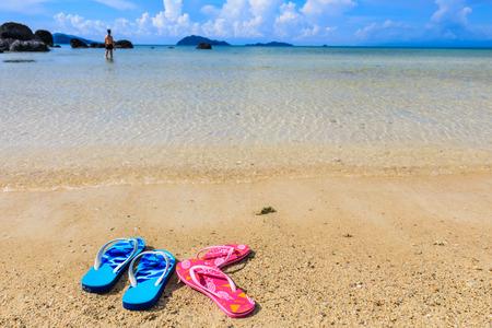 Sandals on  the beach in  Koh Mak island, Trat province,Thailand.