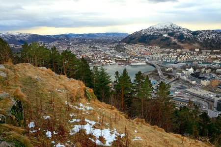 View of Bergen from Mount Floyen in January. Cityscape with fjord and mountains. Norway, Scandinavia.