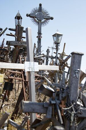Hill of crosses or Kryziu kalnas in Siauliai, Lithuania. Famous site of catholic pilgrimage. A large number of wooden crosses, crucifixes and religious sculptures. Monument of faith and folk art.