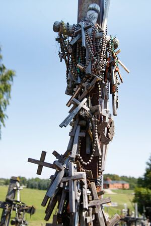 Wooden rucifixes from the Hill of crosses or Kryziu kalnas. Famous site of catholic pilgrimage in Siauliai, Lithuania. Monument of faith and religious folk art.