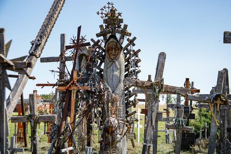 Hill of crosses or Kryziu kalnas. Famous site of catholic pilgrimage in Siauliai, Lithuania. A large number of wooden crosses, crucifixes and religious sculptures. Monument of faith and folk art.