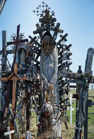 Hill of crosses or Kryziu kalnas in in Siauliai, Lithuania. Famous site of catholic pilgrimage. A large number of wooden crosses, crucifixes and religious sculptures. Monument of faith and folk art. Stock fotó