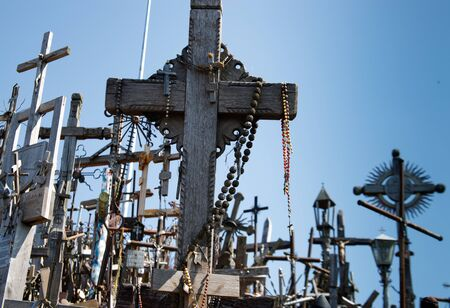 Hill of crosses or Kryziu kalnas. Famous site of catholic pilgrimage in Siauliai, Lithuania. A large number of wooden crosses, crucifixes. Impressive monument of faith and folk art.