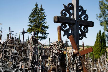 Hill of crosses or Kryziu kalnas. Famous site of catholic pilgrimage in Siauliai, Lithuania. A large number of wooden crosses, crucifixes and beads. Impressive monument of faith and folk art.