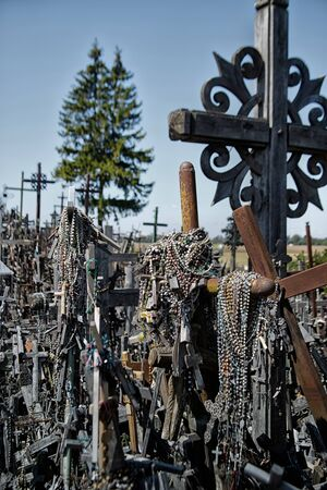 Hill of crosses or Kryziu kalnas. Famous site of catholic pilgrimage in Siauliai, Lithuania. A large number of wooden crosses, crucifixes and rosary beads. Impressive monument of faith and folk art.