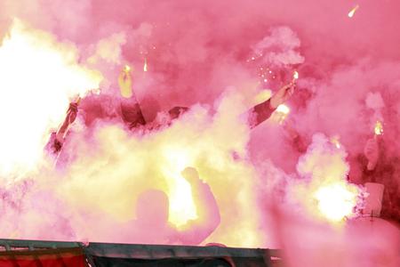 Fans on soccer stadium firework