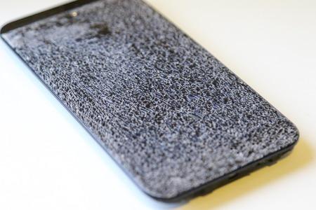 Mobile phone with broken screen Imagens