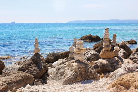 Beautiful seascape,  little stones pyramids Stock Photo