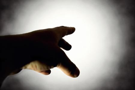 hand reaching light Reklamní fotografie