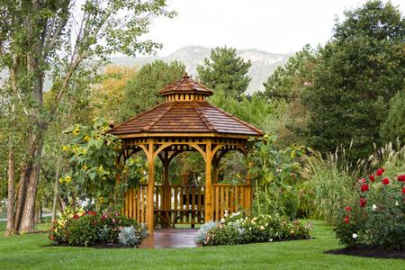 Cedar gazebo in city park. Stock Photo