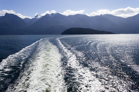 Wake from a passenger ferry in Howe Sound traveling between Horseshoe Bay Terminal and Langdale Terminal in British Columbia, Canada.