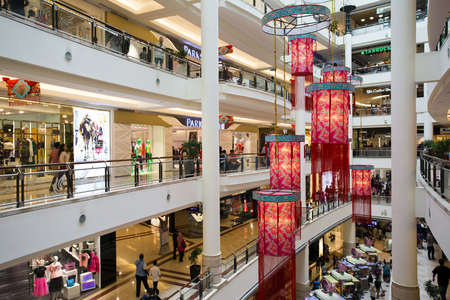 commercialism: Kuala Lumpur, Malaysia - January 27, 2017: Interior of Suria KLCC a shopping mall located in the world famous Petronas Twin Towers in central Kuala Lumpur, Malaysia. KLCC is one of the top shopping destinations in Kuala Lumpur and Malaysia.