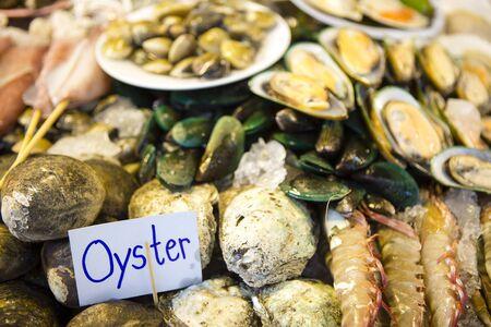 Fresh shellfish seafood at a local market in Phuket, Thailand. Stock Photo