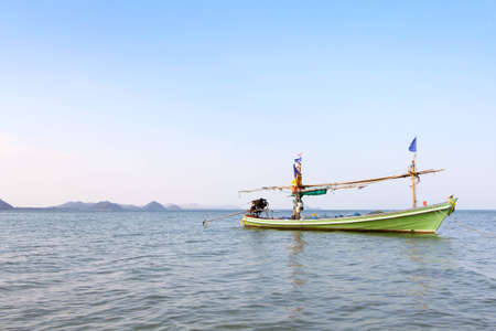 green boat: Green boat in the sea