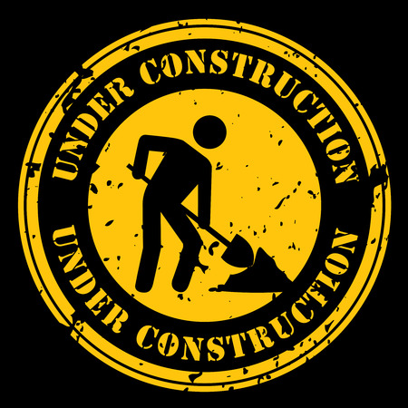 Round icon with the words Under Construction with a man shoveling in black and yellow.