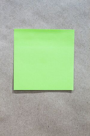 Brown gradient paper background with green note paper Stock Photo - 17699148