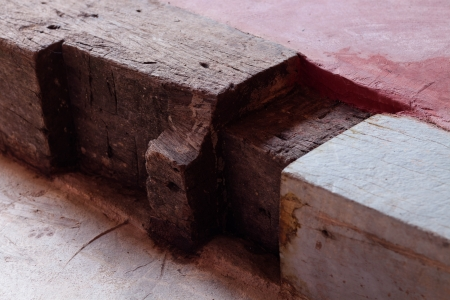 Wooden step on red concrete floor Stock Photo