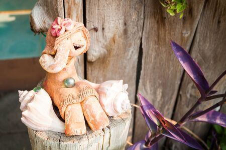 Happy clay doll used in ornamental garden photo