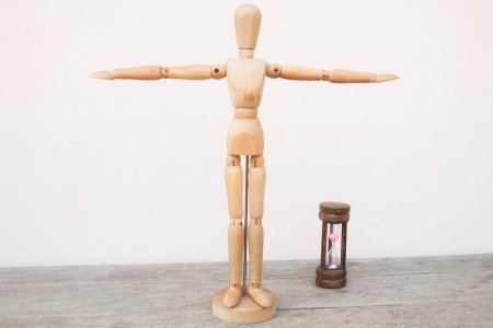 extend: Wooden mannequin extend the arms of count down