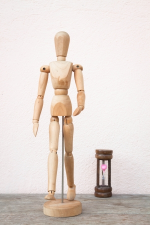 Wooden mannequin pose in concept of progress time photo