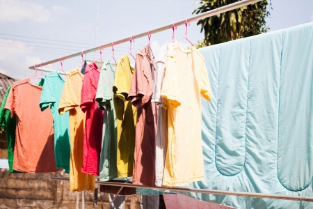 Dry clothes in the air with sun light photo