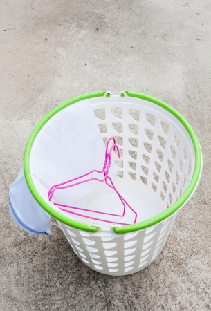 Cloth hanger and wash bag in plastic laundry basket