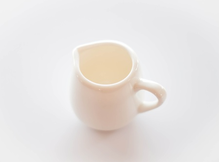 Empty white ceramic pitcher on clean table photo