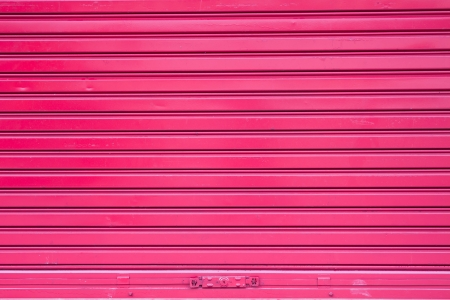 Red roller metal door surface of apartment photo