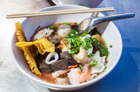 Thai noodle style with red tofu and seafood photo