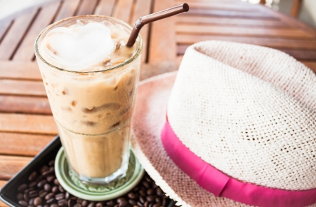 Coffee break with iced espresso at coffee shop