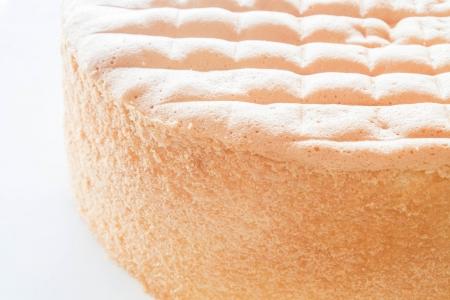 Vanilla sponge cake base for decoration on white background Stock Photo