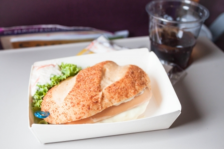 Easy meal with sausage burger served on the plane