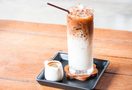 Cold coffee latte with espresso shot in white jar