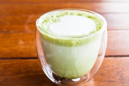 Hot matcha green tea latte glass with milk microfoam