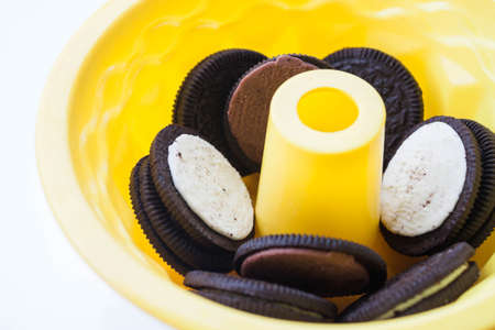 Silicone cake form and cookies on white background
