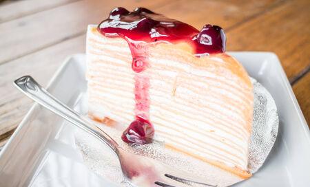Delicious crepe cake with blueberry melt sauce, stock photo photo