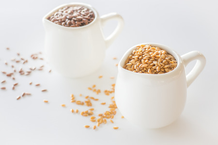 Ceramic pitcher of organic flaxseed, stock photo