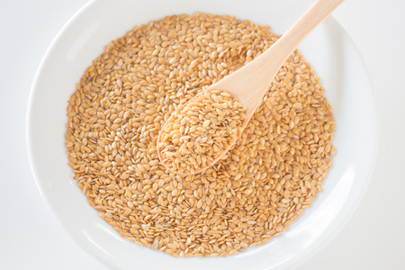 gold flax: Gold flax seeds on a wooden spoon, stock photo Stock Photo