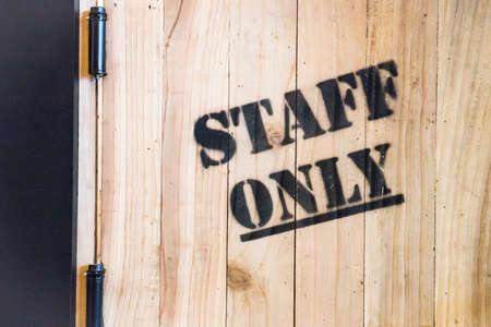 staff only: Staff only sign on wooden background, stock photo