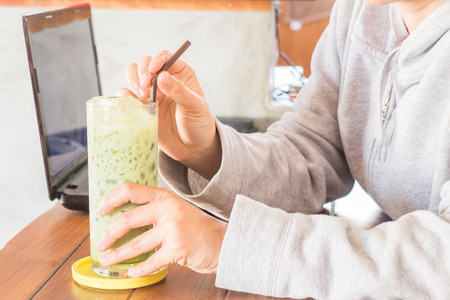 Glass of iced green tea latte, stock photo