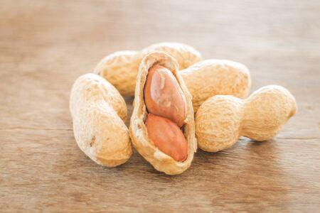 earthnuts: Salted peanuts on weathered wood Stock Photo
