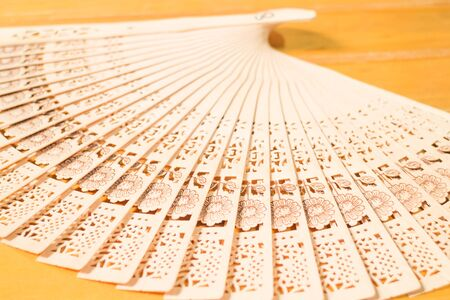 blowhole: Oriental carved wooden hand fan, stock photo