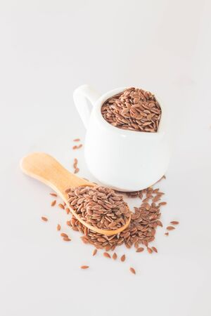 brown flax: Brown flax seed on clean kitchen table, stock photo